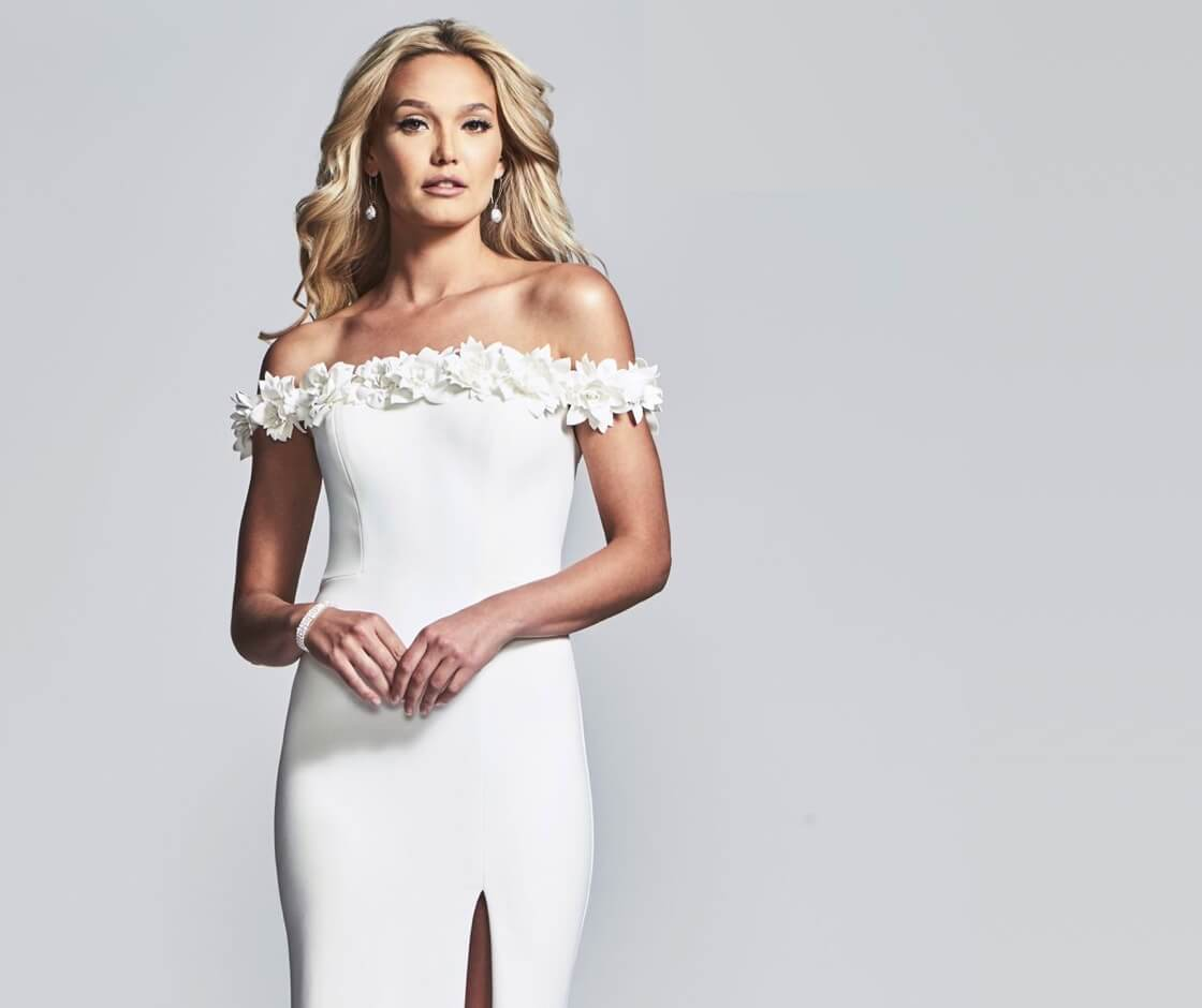 Model wearing Boom Babies white dresses